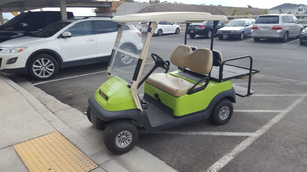 The cute green kart that I rode in when the keeper of the condos told me I couldn't pass out cards there.