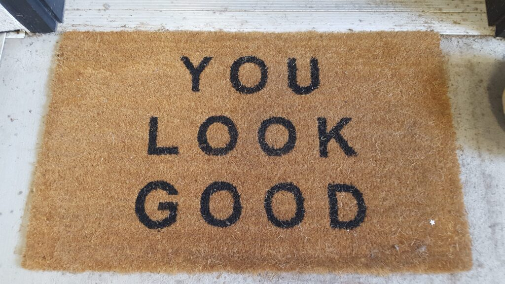 """Door mat with the phrase """"You Look Good."""" From my cards experiment."""