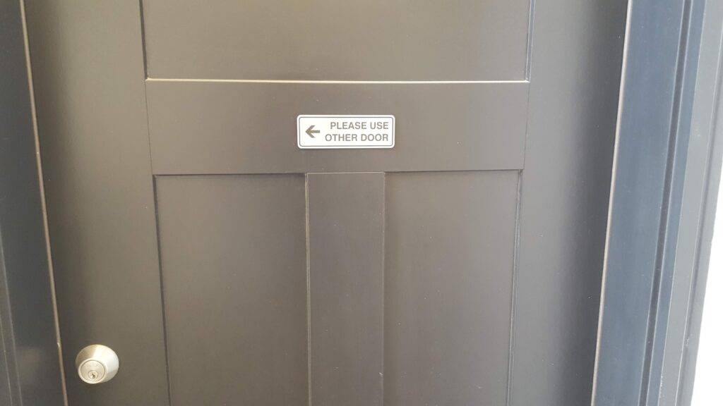 """Classic """"please use other door"""" sign, which was funny because it was the only door to the home. From my cards experiment."""