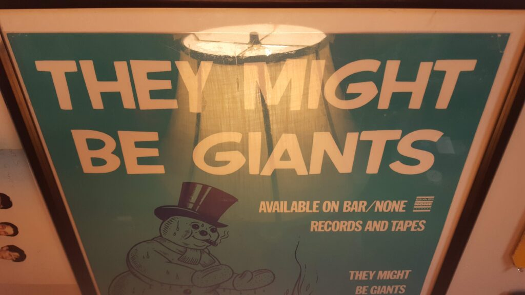 A classic old They Might Be Giants poster in my creative space.