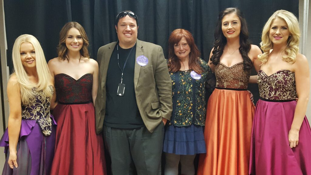 My and mom with pretty singing girls. Hey, one tip for fat people, sport coats hide the extra 80 pounds very effectively.